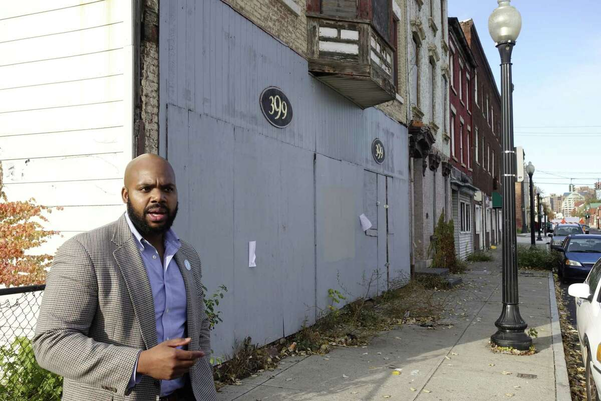 Jahkeen Hoke, COO and strategic planning and development for Upstate New York Black Chamber of Commerce, stands on South Pearl Street as he talks about plans to bring entrepreneurs to the empty buildings, during an interview on Wednesday, Nov. 7, 2018, in Albany, N.Y. Hoke grew up in this neighborhood. (Paul Buckowski/Times Union)