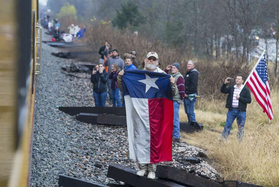 People watch along the route as the train carrying former President George H.W. Bush travels from Houston to College Station for President Bush's burial, Thursday, Dec. 6, 2018. Photo: Mark Mulligan/Staff Photographer
