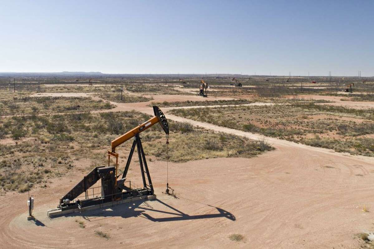 Pumpjacks operate on oil wells in the Permian Basin in Crane. The Permian is driving record U.S. production and exports.