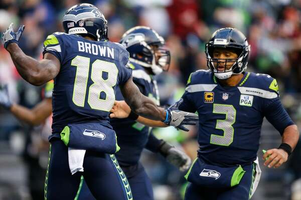 SEATTLE, WA - DECEMBER 02: Jaron Brown #18 of the Seattle Seahawks celebrates a third quarter touchdown with Russell Wilson #3 against the San Francisco 49ers at CenturyLink Field on December 2, 2018 in Seattle, Washington. (Photo by Otto Greule Jr/Getty Images)