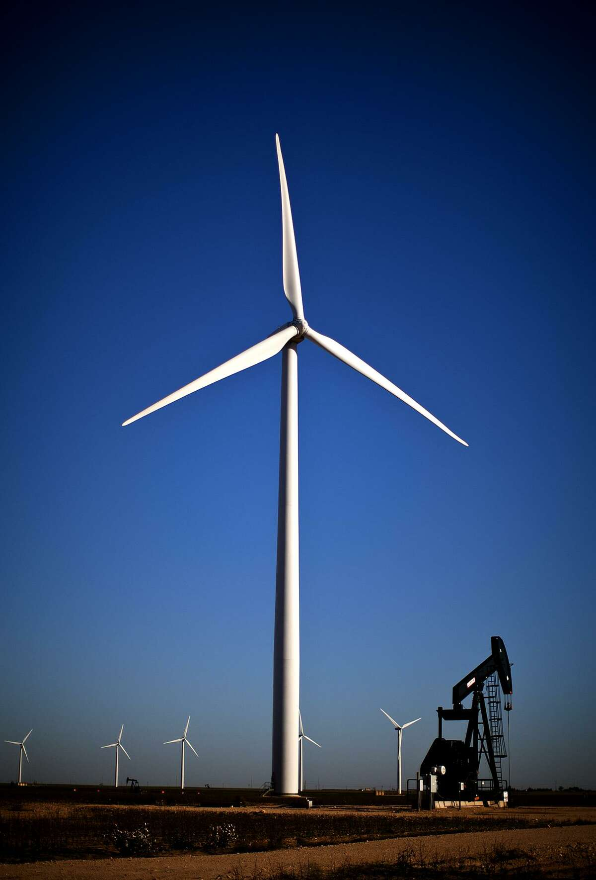 Wind turbines and oil pumpjack in action.