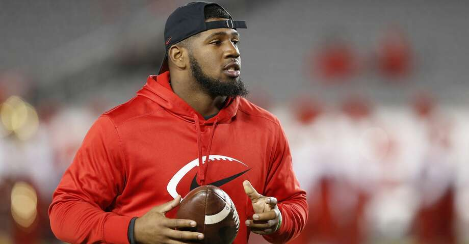 HOUSTON, TX - NOVEMBER 15:  Ed Oliver #10 of the Houston Cougars watches players warm up before the game against the Tulane Green Wave at TDECU Stadium on November 15, 2018 in Houston, Texas.  (Photo by Tim Warner/Getty Images) Photo: Tim Warner/Getty Images