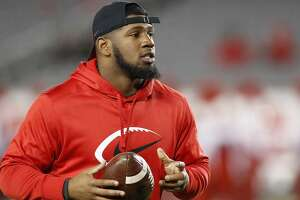 HOUSTON, TX - NOVEMBER 15:  Ed Oliver #10 of the Houston Cougars watches players warm up before the game against the Tulane Green Wave at TDECU Stadium on November 15, 2018 in Houston, Texas.  (Photo by Tim Warner/Getty Images)