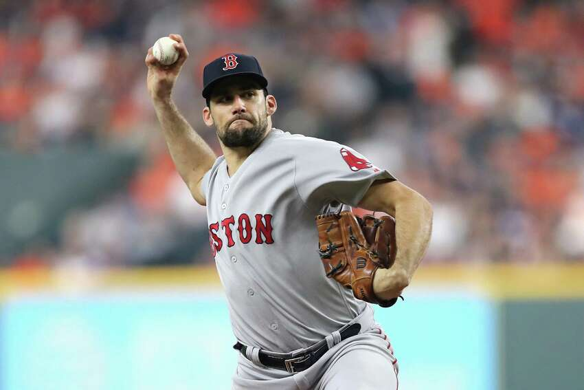 HOUSTON, TX - OCTOBER 16: Nathan Eovaldi #17 of the Boston Red Sox pitches in the first inning against the Houston Astros during Game Three of the American League Championship Series at Minute Maid Park on October 16, 2018 in Houston, Texas. (Photo by Elsa/Getty Images)