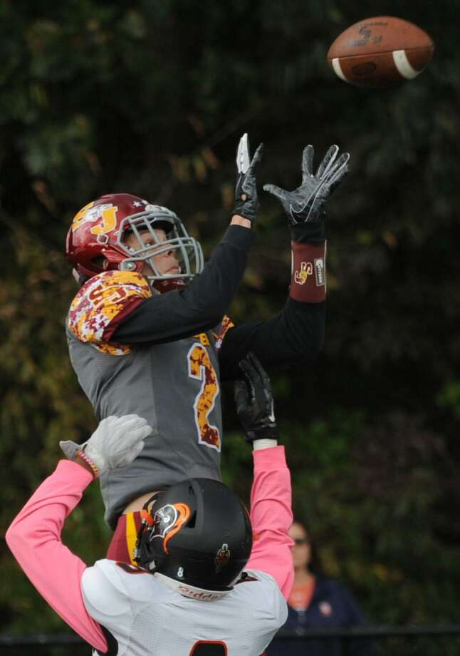 St. Jsoeph wide receiver Jesse Bike tries to come down with a pass in the end zone against Stamford on Oct. 20 in Trumbull. Photo: Erik Trautmann / Hearst Connecticut Media / Connecticut Post