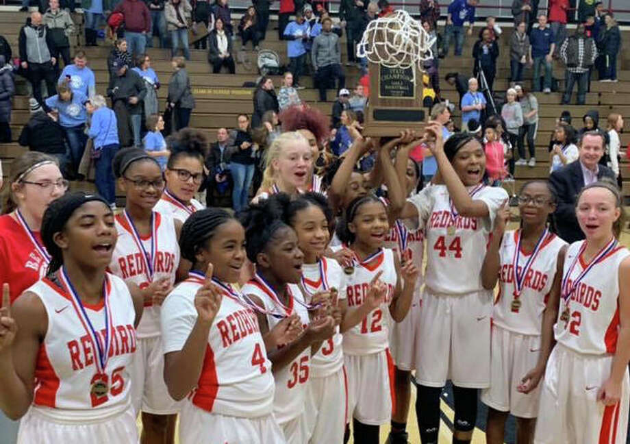 The Alton Middle School 7th grade girls basketball team captured the 7A state championship Thursday night, defeating Shorewood Troy 56-48. The championship tied a bow on the squad's undefeated 23-0 season. Photo: Alton Community School District #11 Facebook Page