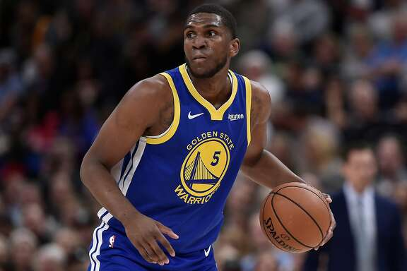 SALT LAKE CITY, UT - OCTOBER 19: Kevon Looney #5 of the Golden State Warriors controls the ball in a NBA game against the Utah Jazz at Vivint Smart Home Arena on October 19, 2018 in Salt Lake City, Utah. NOTE TO USER: User expressly acknowledges and agree