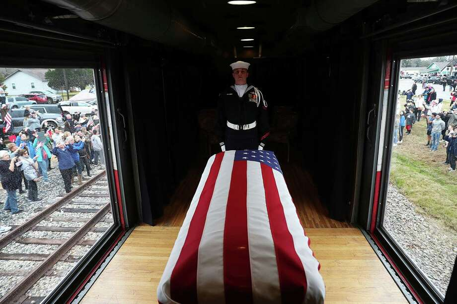 UNSPECIFIED, TEXAS - DECEMBER 06:   U.S. Navy ceremonial guard Hm2 Kenneth Knox stands over the the flag-draped casket of former President George H.W. Bush as members of the public line the route to pay their respects as the train carrying his body to his final resting place proceeds on December 6, 2018 in Texas. President Bush will be buried at his final resting place at the George H.W. Bush Presidential Library at Texas A&M University in College Station, Texas. A WWII combat veteran, Bush served as a member of Congress from Texas, ambassador to the United Nations, director of the CIA, vice president and 41st president of the United States. (Photo by Joe Raedle/Getty Images) Photo: Joe Raedle / 2018 Getty Images