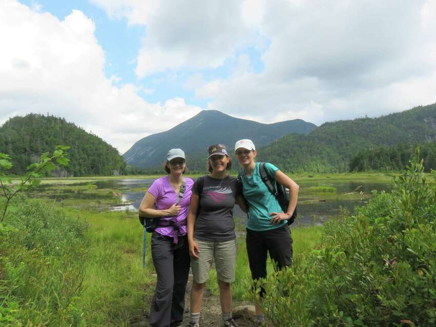 Outdoors writer Gillian Scott and two friends pose at Flowed Lands in the Adirondack High Peaks in 2016. They were guided there as part of a wilderness weekend, a gift from her husband, Herb Terns. (Photo provided by Gillian Scott)