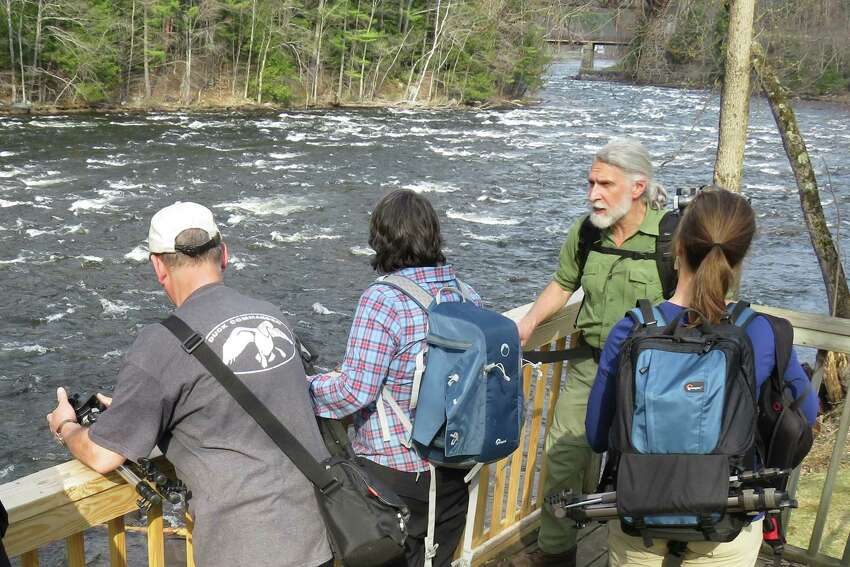Photographer Carl Heilman offers tips to students along the Sacandaga River near Hadley in 2015. The photographer class, offered through the Adirondack Folk School, made for an