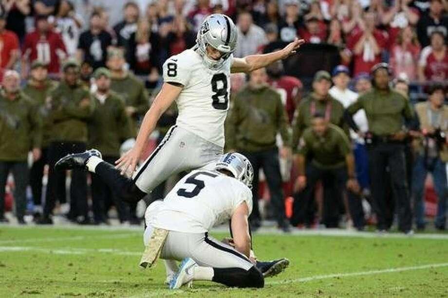 The Raiders' Daniel Carlson kicks the game-winning, 35-yard field goal against the Cardinals, putting Oakland on top 23-21. Photo: Jennifer Stewart / Getty Images
