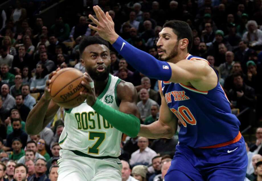 Boston Celtics guard Jaylen Brown (7) drives against New York Knicks center Enes Kanter (00) during the first quarter of an NBA basketball game Thursday, Dec. 6, 2018, in Boston. (AP Photo/Elise Amendola) Photo: Elise Amendola / Copyright 2018 The Associated Press. All rights reserved