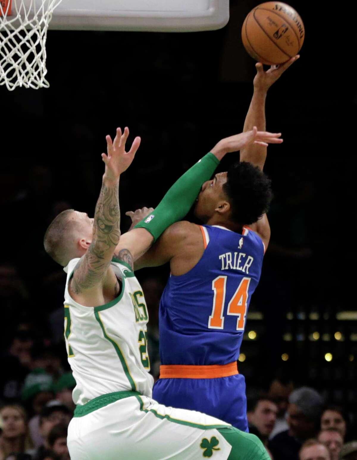 New York Knicks guard Allonzo Trier (14) tries to shoot over Boston Celtics forward Daniel Theis (27) during the first quarter of an NBA basketball game Thursday, Dec. 6, 2018, in Boston. (AP Photo/Elise Amendola)