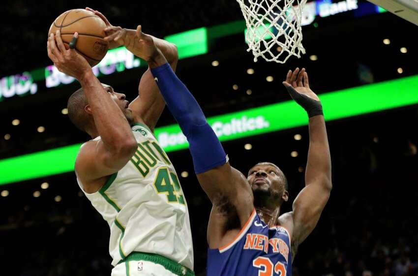 Boston Celtics center Al Horford (42) is defended by New York Knicks forward Noah Vonleh (32) during the second quarter of an NBA basketball game Thursday, Dec. 6, 2018, in Boston. (AP Photo/Elise Amendola)