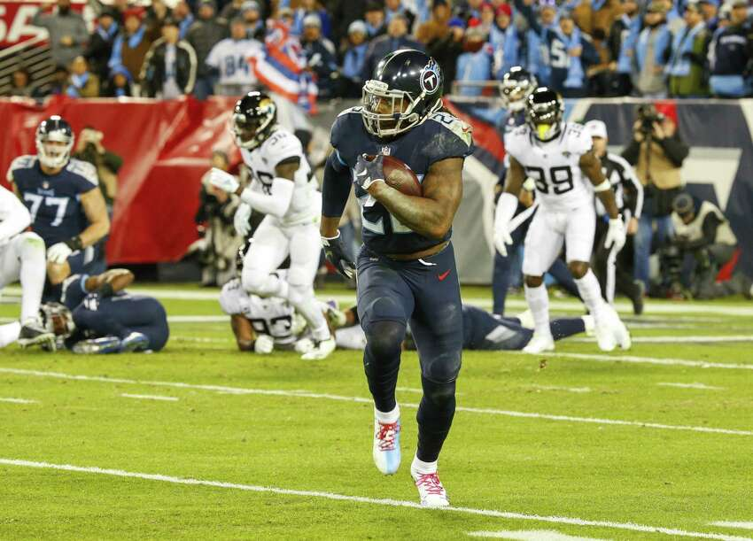 NASHVILLE, TN - DECEMBER 6: Derrick Henry #22 of the Tennessee Titans runs downfield with the ball for a 99 yard touchdown against the Jacksonville Jaguars at Nissan Stadium on December 6, 2018 in Nashville, Tennessee. (Photo by Frederick Breedon/Getty Images)