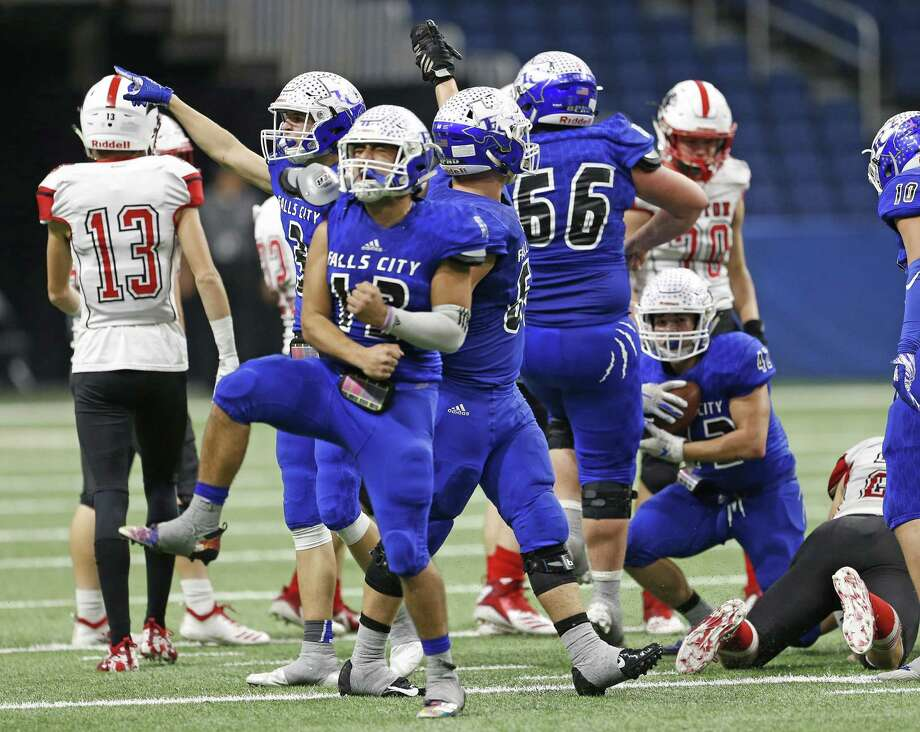 Derrick Gonzalez and Falls City celebrate a fumble recovery in their 30-28 regional final win over Burton at the Alamodome. Photo: Ronald Cortes / Contributor / 2018 Ronald Cortes