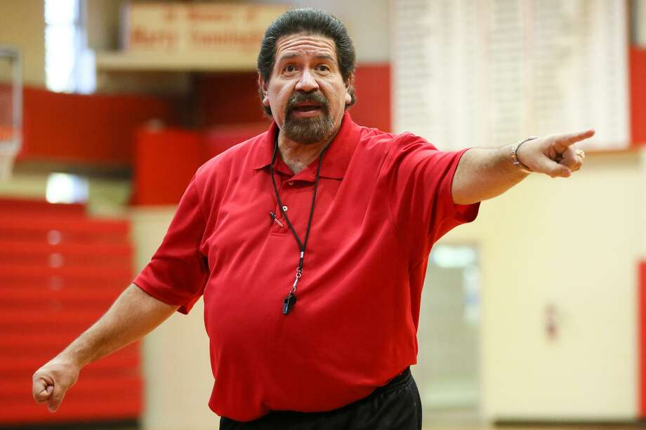 Antonian boys basketball coach Rudy Bernal earned his 650th career victory Tuesday with the Apaches' 82-71 win over Harlan. Photo: Marvin Pfeiffer /Staff Photographer / Express-News 2015