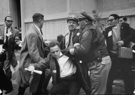 Student protestor Mario Savio being roughed up by two Berkeley cops as they arrest him during student riot at Free Speech Movement demonstration on campus at Univ. of CA. (Photo by Nat Farbman/The LIFE Picture Collection/Getty Images) Student protestor Mario Savio (C) being roughed up by two Berkeley cops as they arrest him during student riot at Free Speech Movement demonstration on campus at Univ. of CA.  (Photo by Nat Farbman/The LIFE Picture Collection/Getty Images)
