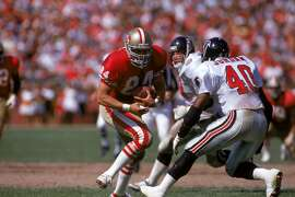SAN FRANCISCO - SEPTEMBER 23:� Tight end Brent Jones #84 of the San Francisco 49ers runs for yards against Atlanta Falcons safety Brian Jordan #40 during a game at Candlestick Park on September 23, 1990 in San Francisco, California.� The 49ers won 19-13.� (Photo by