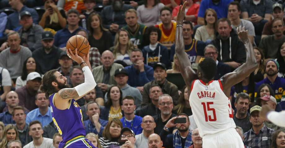 Utah Jazz guard Ricky Rubio (3) shoots as Houston Rockets center Clint Capela (15) defends during the first half during an NBA basketball game Thursday Dec. 6, 2018, in Salt Lake City. (AP Photo/Rick Bowmer) Photo: Rick Bowmer/Associated Press