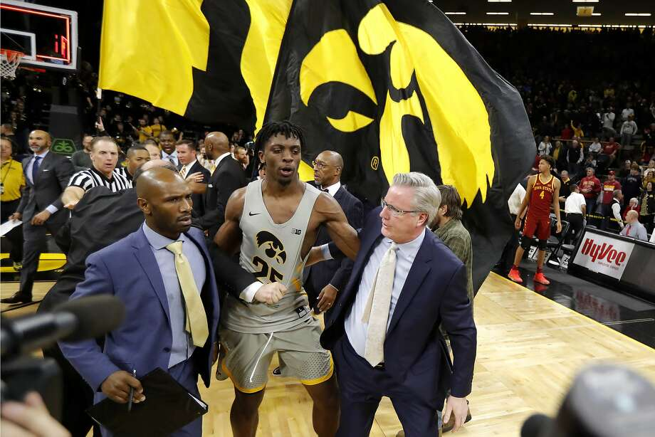 Iowa forward Tyler Cook, center, walks off the court with head coach Fran McCaffery, right, after an NCAA college basketball game against Iowa State, Thursday, Dec. 6, 2018, in Iowa City, Iowa. (AP Photo/Charlie Neibergall) Photo: Charlie Neibergall / Associated Press