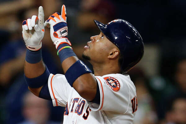 Houston Astros third baseman Luis Valbuena (18) reacts after his solo home run in the sixth inning of an MLB baseball game at Minute Maid Park,Wednesday, May 25, 2016. ( Karen Warren / Houston Chronicle )