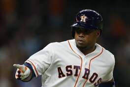 Houston Astros third baseman Luis Valbuena (18) points into the dugout as he rounds the bases after his two-run home run in the second inning of an MLB baseball game at Minute Maid Park,Thursday, May 26, 2016. ( Karen Warren / Houston Chronicle )