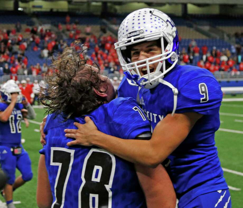 Falls City's Tay Yanta with Falls City's Caleb Villarreal at the end of the game from the Region IV-2A Division II final football game between Falls City and Burton on Thursday, December 6, 2018 at the Alamodome. Photo: Ronald Cortes/Contributor / 2018 Ronald Cortes