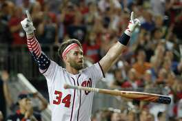 Washington Nationals Bryce Harper (34) reacts to his winning hit during the Major League Baseball Home Run Derby, Monday, July 16, 2018 in Washington. (AP Photo/Alex Brandon)