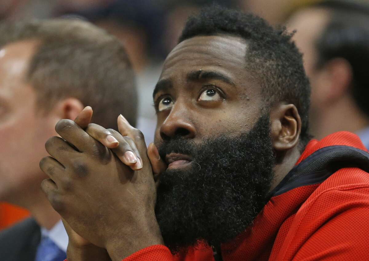 Houston Rockets guard James Harden watches from the bench after leaving the game in the second half during an NBA basketball game against the Utah Jazz Thursday Dec. 6, 2018, in Salt Lake City. (AP Photo/Rick Bowmer)