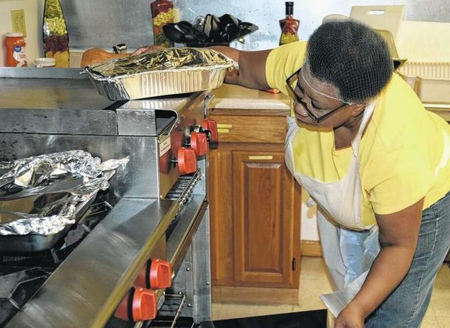 Polly Pulley, pastor of Spirit of Faith Church, prepares food Thursday for the church's soup kitchen. Photo: Samantha McDaniel-Ogletree | Journal-Courier