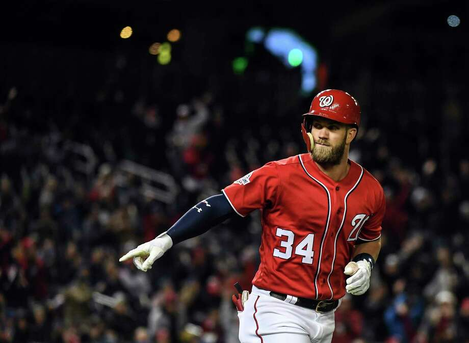 Washington Nationals right fielder Bryce Harper (34) point to the Washington Nationals' dugout after hitting a two-run homer against the New York Mets at Nationals Park on April 8, 2018. Photo: Washington Post Photo By Toni L. Sandys. / The Washington Post