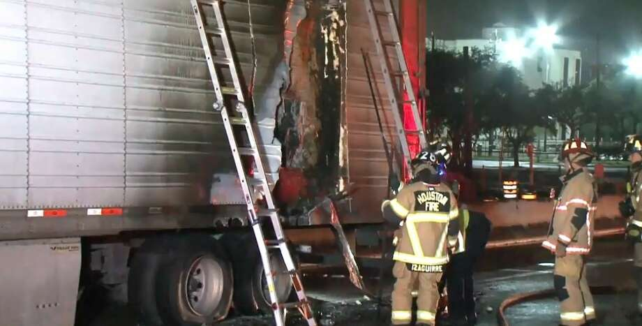 An 18-wheeler caught fire on the Southwest Freeway on Friday, Dec. 7, 2018. Photo: Metro Video