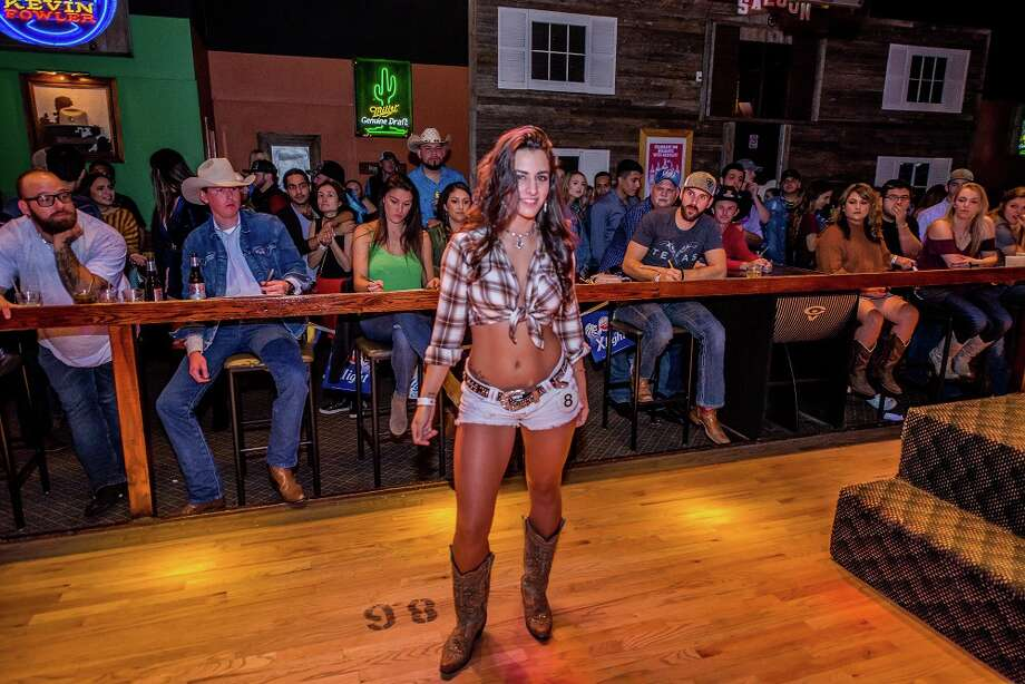 Cowboys and cowgirls got 'wild' Thursday night at San Antonio's country bar Wild West. Photo: Kody Melton