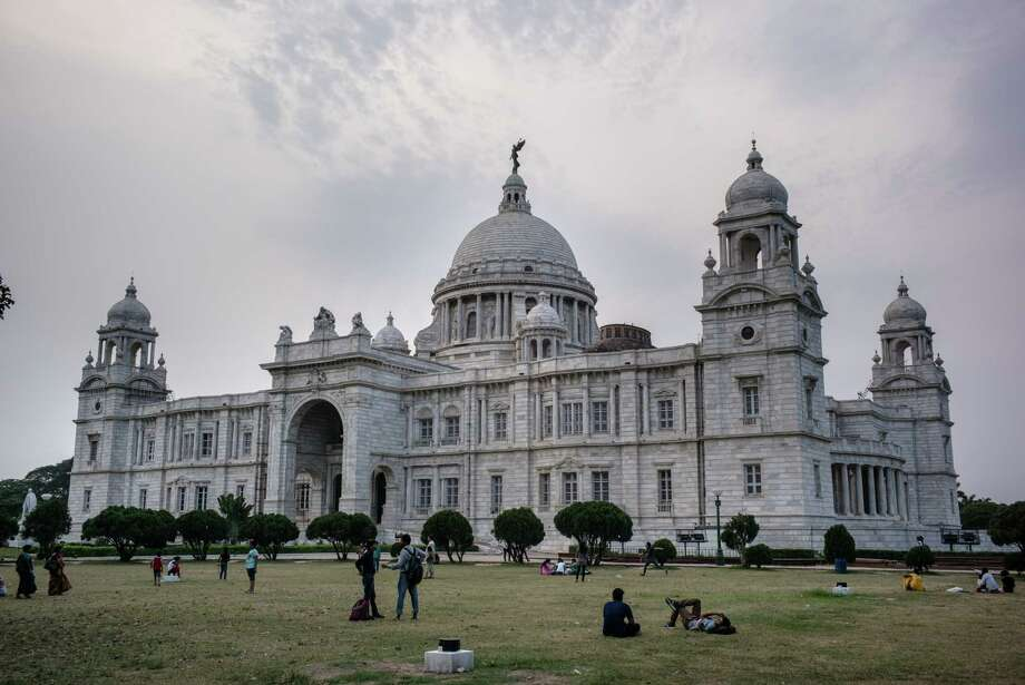 Visitors relax on a grass lawn in front of the Victoria Memorial in Kolkata, India, on Friday, May 26, 2017. India is scheduled to release first-quarter gross domestic product figures on May 31. Photographer: Sanjit Das/Bloomberg ORG XMIT: 700057745 Photo: Sanjit Das / © 2017 Bloomberg Finance LP
