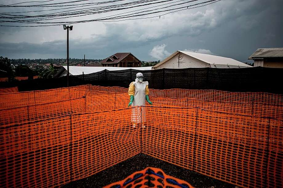 TOPSHOT - A health worker waits to handle a new unconfirmed Ebola patient at a newly build MSF (Doctors Without Borders) supported Ebola treatment centre (ETC) on November 7, 2018 in Bunia, Democratic Republic of the Congo. - The death toll from an Ebola outbreak in eastern Democratic Republic of Congo has risen to more than 200, the health ministry said on November 10, 2018. (Photo by John WESSELS / AFP)        (Photo credit should read JOHN WESSELS/AFP/Getty Images) Photo: JOHN WESSELS/AFP/Getty Images