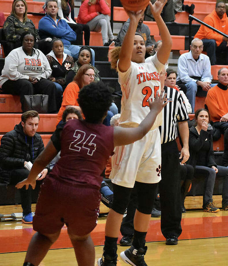 Edwardsville freshman Sydney Harris attempts to knock down a 3-pointer during the third quarter against Belleville West on Thursday. Photo: Matt Kamp / Hearst Illinois
