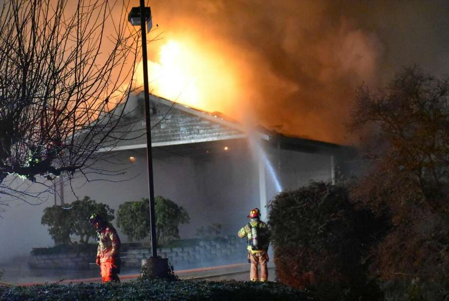 A fire burns the Kingdom Hall of a Jehovah's Witnesses church in Lacey. (Photo: Kyle Fievez) Photo: Photo: Kyle Fievez Via KOMO News