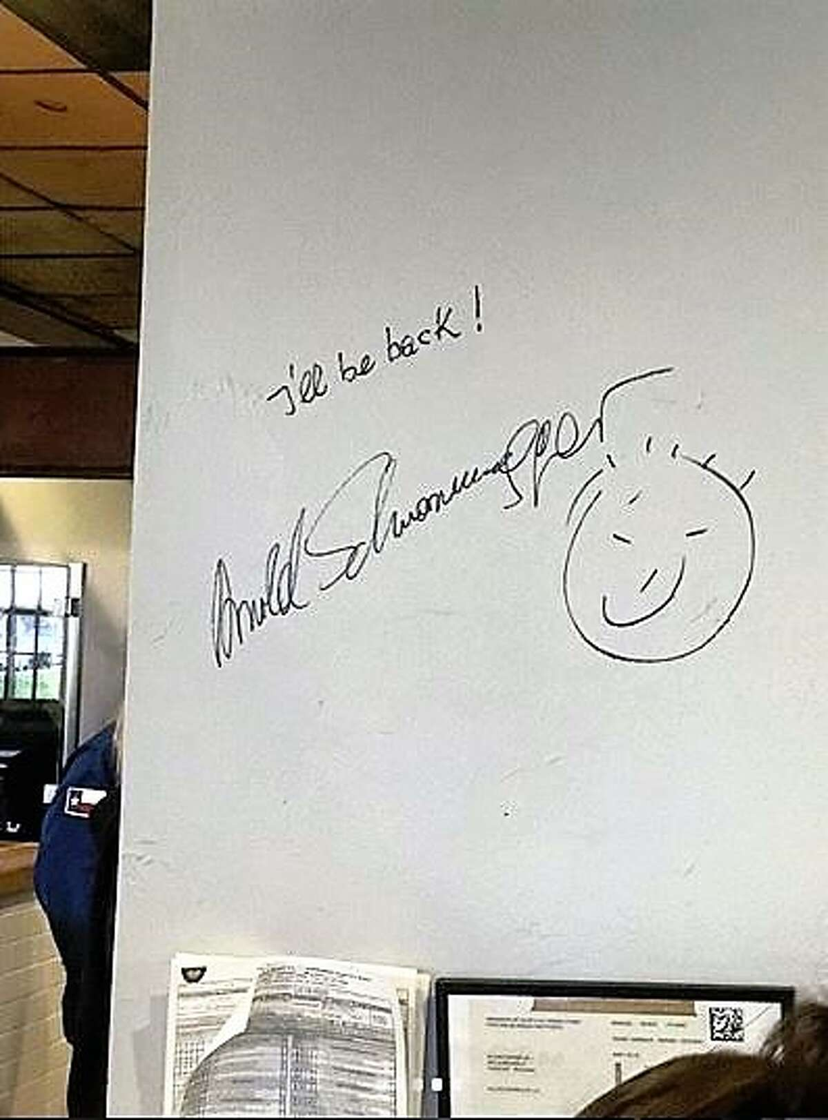 Schwarzenegger signed his name on one of the interior walls at Killen's Barbecue.