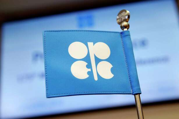 The OPEC flag on a desk ahead of a news conference at the 175th Organization Of Petroleum Exporting Countries (OPEC) meeting in Vienna, Austria, on Dec. 6, 2018.