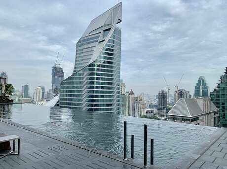$431 SFO to Bangkok roundtrip. See the infinity rooftop pool at the Okura Prestige hotel looking out at the new Park Hyatt in Bangkok Photo: Barkley Dean
