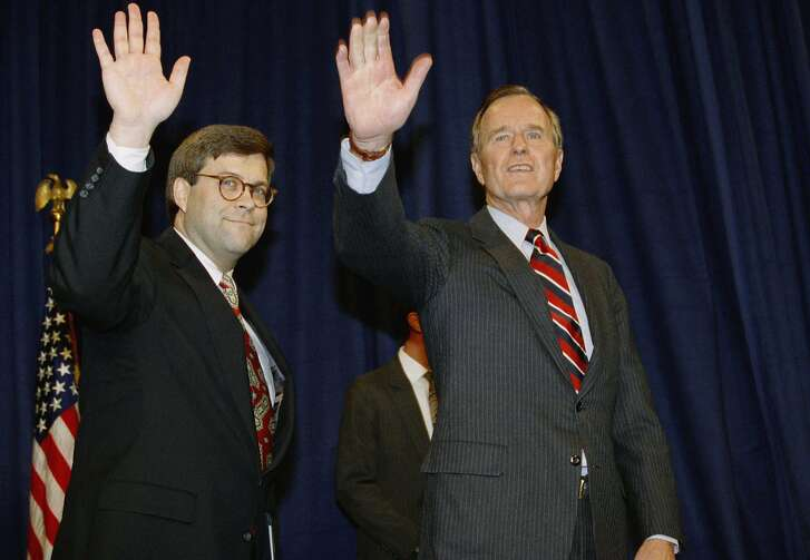 FILE - In this Nov. 26, 1991, file photo, President George H.W Bush, right, and William Barr wave after Barr was sworn in as the new Attorney General of the United States at a Justice Department ceremony in Washington. President Donald Trump said Friday he will nominate William Barr, former President George H.W. Bush's attorney general, to serve in the same role.   (AP Photo/Scott Applewhite, File)