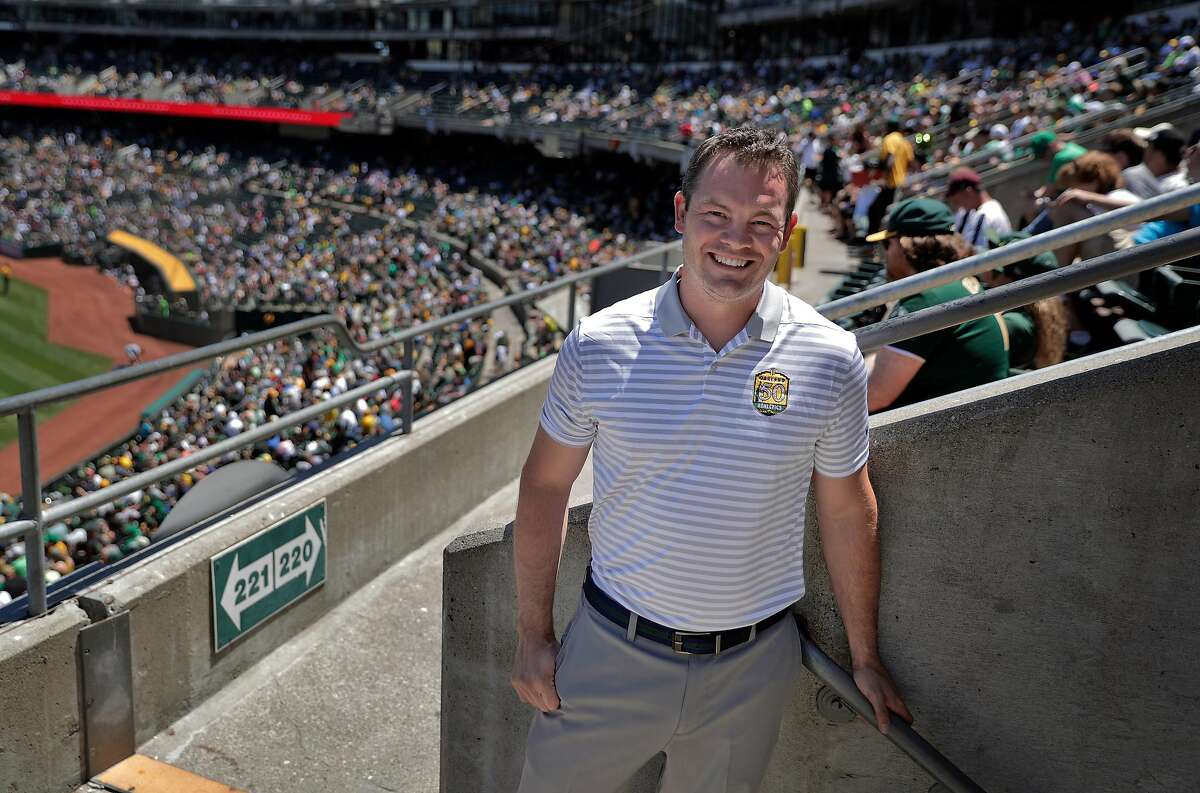 The Athletics Chief Operating Officer, Chris Giles in the stands as the Oakland Athletics played against the Detroit Tigers at the Coliseum in Oakland, Calif., on Sunday, August 5, 2018.