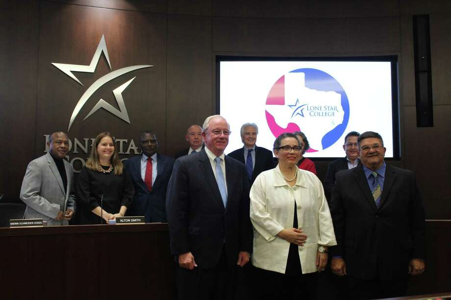 The three new Lone Star College System trustees Mike Sullivan, Ernestine Pierce and Mike Stoma (front) were welcomed onto the board at the meeting Thursday, Dec. 6. The rest of the board, Ken Lloyd, Myriam Saldívar, Alton Smith, Chancellor Steve Head, David Vogt, Linda Good and Art Murillo stand behind them. Photo: Jane Stueckemann/The Villager / Photograph By Jane Stueckemann