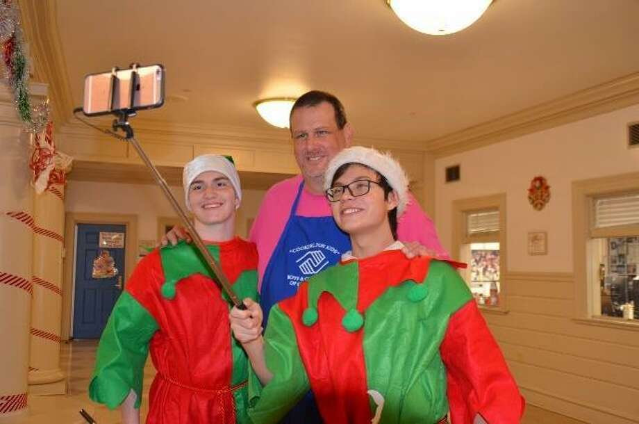 Elfies take Selfies with Don Palmer, the program director at the Boys & Girls Club of Greenwich, at the annual Pancake Breakfast with Santa, which will be held from 8 to 11 a.m. Saturday at the clubhouse at 4 Horseneck Lane. For info, call 203-869-3224 or visit BGCG.org. Photo: Contributed /