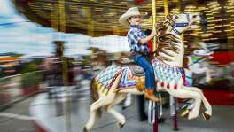 Hudson Rich, 4, rides the merry-go-round at the Houston Livestock Show and Rodeo Friday, March 9, 2018 in Houston.