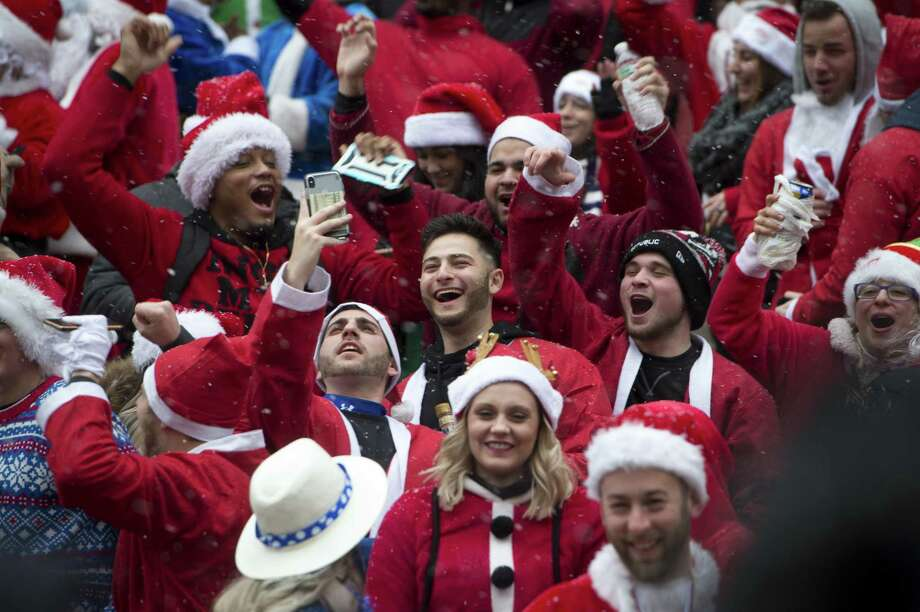 Revelers take part in New York's SantaCon in Midtown Manhattan on Saturday, Dec. 9, 2017. (Howard Simmons/New York Daily News.) Photo: Howard Simmons / TNS / New York Daily News