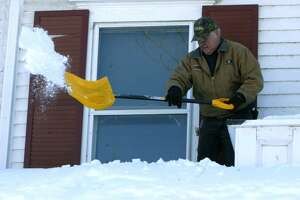 File photo of snow being removed from the Cohen Building on Bridge Street.