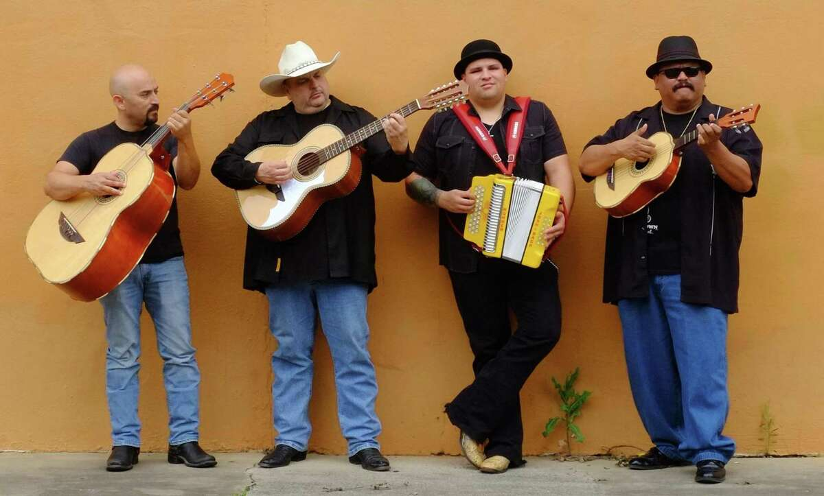 Max Baca (second from left), with his band Los Texmaniacs, says he has to work to pay his bills. The other band members are Noel Hernandez (from left), Josh Baca (accordion) and Lorenzo Martinez.