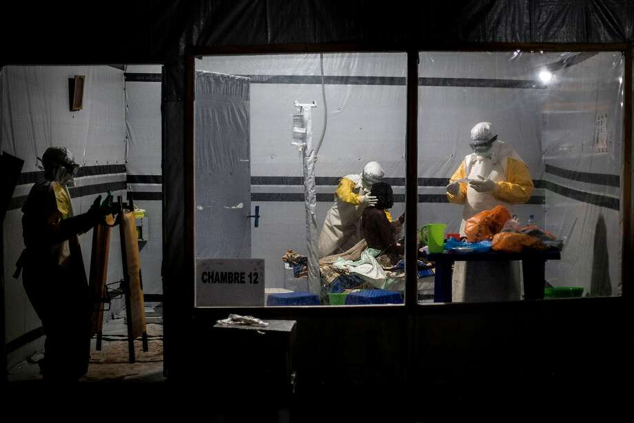 Health workers treat an unconfirmed Ebola patient in Butembo, a city with more than 1 million people. Photo: John Wessels / AFP / Getty Images